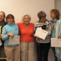 swiss-practitioners-receiving-their-upgrade-certificates-to-ttouch-practitioner-3-for-companion-animals-teresa-cottarelli-guenter-maya-conochi-ltjk-lisa-leicht-with-golfy-in-her-arms